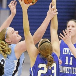 Jaymie Druding (left) of the University of Maine pressures Central Connecticut State University's Kirsten Daamen as Daamen tries to grab a rebound during the second half of Tuesday night's game at Alfond Arena in Orono. CCSU's Lauren Arbogast (11) awaits the outcome. Central Connecticut won 62-57.