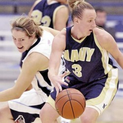 Erin Edwards (3) of Navy spins away from defensive pressure by Katelyn Vanderhoff of the University of Maine during the second half of Friday's Dead River Co. Classic game at Alfond Arena in Orono. The Midshipmen won 65-43.