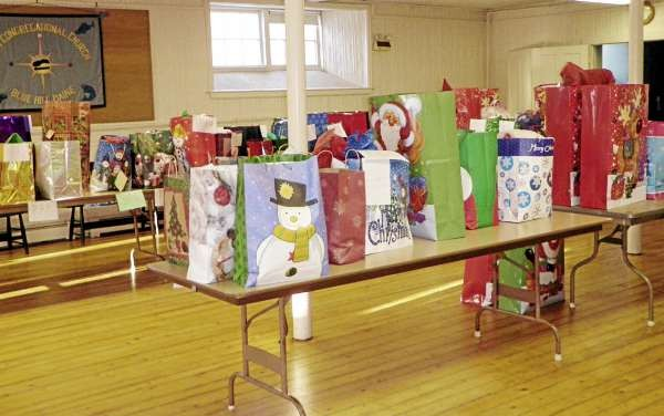Wrapped and ready to go last December these Christmas presents, purchased adn wrapped by the Christmas Angel program at the First Congregational Church of Blue Hill, were delivered to 215 children in 87 needy families in the area. The Christmas Angels program is gearing up for its 22nd season and is looking for angels to participate. Photo courtesy of Kathy Soper