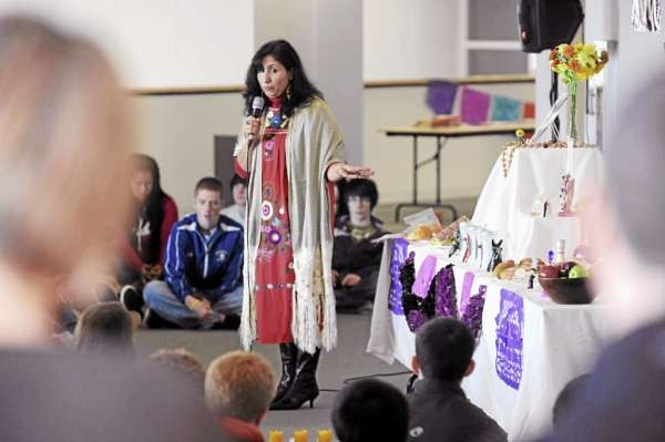 Eunice Loredo, a Spanish teacher at Hampden Academy, lectures students from various schools about the Mexican celebration of the Day of the Dead at the Hudson Museum at the University of Maine in Orono on Monday, November 1, 2010. (Bangor Daily News/Kevin Bennett)