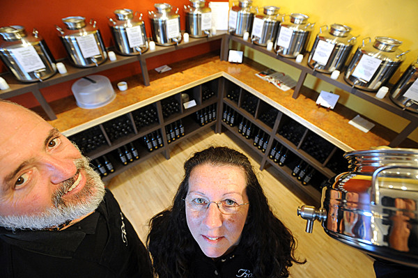 Pat O'Brien (left) and his wife Nancy O'Brien own the Fiore Olive Oil stores in Bar Harbor and Rockland.  The sell 17 varieties of extra virgin olive oil and 16 different balsamic vinegars that ar all imported products.  On the right is a fusti, an Italian made oil or vinegar vessel. (Bangor Daily News/Gabor Degre)