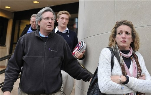 Dr. William A. Petit Jr., left, leaves with his sister Johanna Chapman, center, after jury deliberation Sunday, Nov. 7, 2010, at the New Haven, Conn., County Courthouse. Petit is the sole survivor of the 2007 Cheshire, Conn., home invasion where his wife, Jennifer Hawke-Petit and their daughters, Hayley and Michaela, were murdered. Steven Hayes has been convicted in the triple murder, and the penalty phase of the trial will continue Monday.  (AP Photo/Jessica Hill)