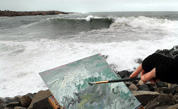 Gail Sauter of Kittery works on an oil painting of the crashing waves at Schoodic Point in Acadia National Park Monday monring, Nov. 8, 2010.  Sauter is the artist in residence at the Acadia National Park Schoodic Education and Research Center and will stay for a month.  &quotI'm trying to capture the phenomenal movement and color of the stormy water,&quot she said.  The storm that knocked out power in many homes in southern Maine produced little more than the wonderful display of waves along the mid-coast. (Bangor Daily News/Gabor Degre)