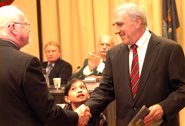 Bangor City Council Chairman Richard Stone (right) shakes hands with Councilor Hal Wheeler during the regular City Council meeting of Monday, Oct. 25, 2010. Stone, a two-term councilor who served as chairman this past year, did not run for re-election because he wants to spend more time with family. His daughter, Ella, 9 (middle) helped preside over Stone's last meeting. (BANGOR DAILY NEWS PHOTO/ERIC RUSSELL)