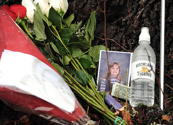 A grade school picture of Katie Kelly rests next to flowers and letters from loved ones on Tuesday, November 9, 2010 at the site on Barnestown Road in Hope where Kelly, 17, died along with Daniel Dodge II, 21, and Misty Leach, 14. (Bangor Daily News/Kevin Bennett)