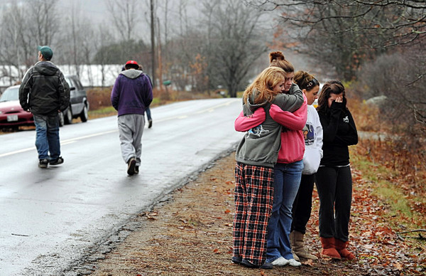 Rockland High School students Jessica Tyler, Fontana Jackson, Danielle Gargan and Brittany Young mourn the loss of their friends Daniel Dodge II, Katie Kelly and Misty Leach at the crash scene along Barnestown Road in Hope on Tuesday, November 9, 2010. All three were killed when the 1980 Ford F-150 pickup truck that Dodge was driving crashed in to a tree late Monday night.  (Bangor Daily News/Kevin Bennett)