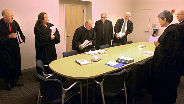 Justices of the Maine Supreme Judicial Court gather in the jury room for a final disussion before entering the courtroom at the Penobscor Judicial Center in Bangor Tuesday morning, Nov. 9, 2010.  The Maine Supreme Court is in session in Bangor for two days.From left are Justice Donald G. Alexander, Chief Justice Leigh I. Saufley, Justice Warren M. Silver, Justice Joseph M. Jabar, Justice Andrew M. Mead, Justice Ellen A. Gorman and Justice Jon D. Levy. (Bangor Daily News/Gabor Degre)