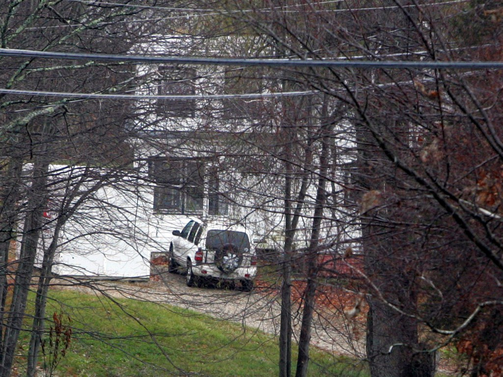 A home is seen in Auburn, N.H. Tuesday, Nov. 9, 2010 where authorities said a woman and her young son where found dead inside. (AP Photo/Jim Cole)