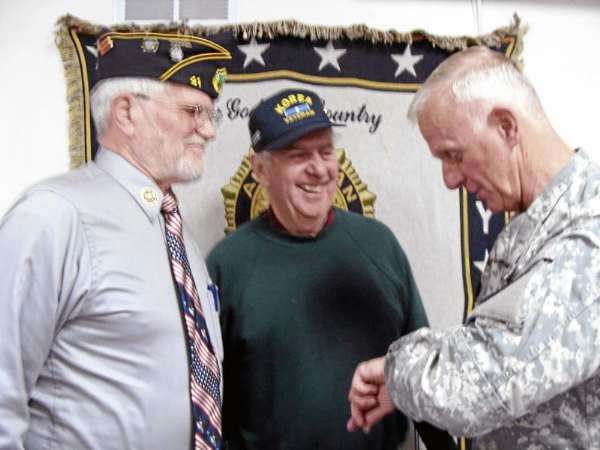 Major General John Libby joked Tuesday with Richard Mullins of Milo, and Ron Coates of Dover-Foxcroft after he spoke during a ceremony for Korean War veterans in Dover-Foxcroft. (Bangor Daily News Photo by Diana Bowley)
