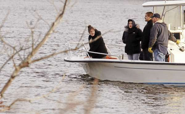 Family and friends of missing Bangor resident William Hilderbrand, 22, start their search from boats along the Hampden shore of the Penobscot River on Wednesday, Nov. 10, 2010.  A person, believed to be Hilderbrand, was seen jumping off the Chamberlain Bridge just before midnight on Nov. 4.  (Bangor Daily News/Scott Haskell)