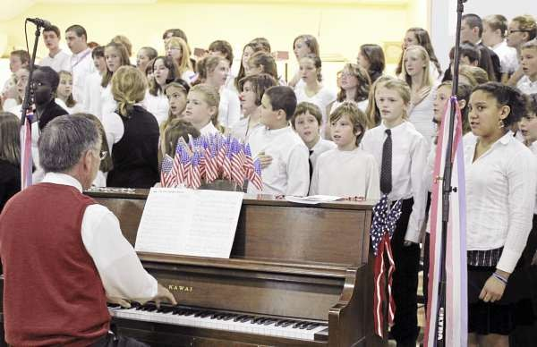 The Rockland District Middle School chorus sang the Star Spangled Banner at a Wednesday morning assembly to honor veterans. The event was part of History Channel?s ?Take a Veteran to School Day? program. (Bangor Daily News/Heather Steeves)
