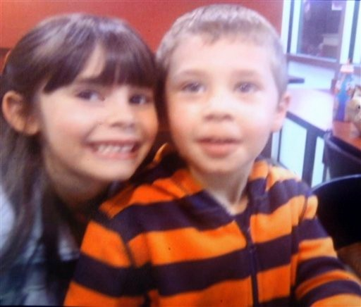 This is an undated family photo of Mason Smeltzer, and his sister Mercey Smeltzer. The children's father Christopher Smeltzer was arraigned Wednesday, Nov. 10, 2010, at District Court in Candia, N.H., and charged with killing their mother. Authorities haven't said who killed the couple's 4-year-old son Mason, who was found strangled alongside his mother in the couple's home Monday. The couple's 7-year-old daughter and Christopher were taken to a hospital for treatment of undisclosed injuries. (AP Photo)