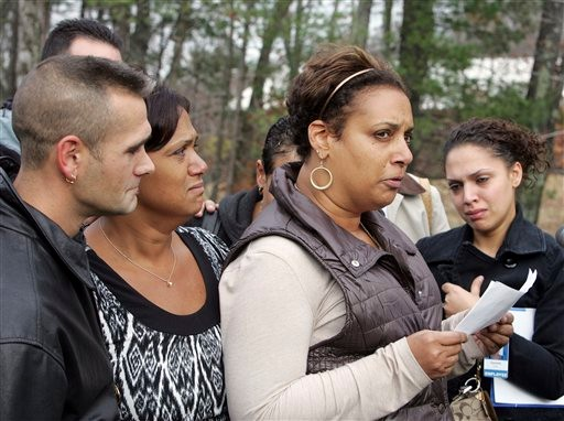 Michele Harris talks about her sister, Mara Pappalardo Smeltzer, outside the District Court, Wednesday, Nov. 10, 2010, in Candia, N.H. Smeltzer and her 4-year-old son were found killed Monday. Her husband Christopher Smeltzer has been charged with her death. Authorities haven't said who killed the couple's son. (AP Photo/Jim Cole)