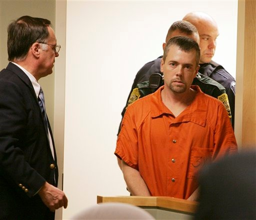 Christopher Smeltzer, 37, arrives for his arraignment Wednesday Nov. 10, 2010 in District Court in Candia, N.H. on a charge he beat his wife to death with a flashlight. Authorities still haven't said who killed the couple's 4-year-old son, Mason, who was found strangled alongside his mother. (AP Photo/Jim Cole)