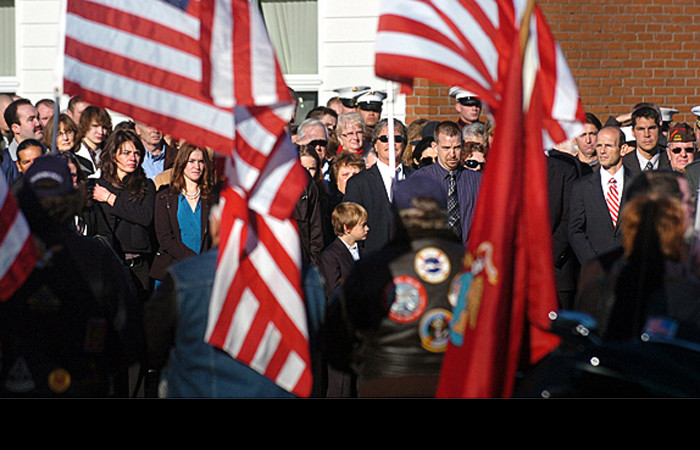 People watch the hurse drive away from Houlton High School after the funeral service for First Lt. James Zimmerman a U.S. Marine who was killed in Afghanistan on November 2nd.  (Bangor Daily News/Gabor Degre)