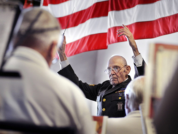 Henry 'Hank' Watson , himself a WW2 veteran as well as an assistant conductor of The Bangor Band, conducts one of several pieces that were performed at the Cole Land Transportation Museum by the band as part of Veterans Day ceremonies. Bangor Daily News/Michael C. York