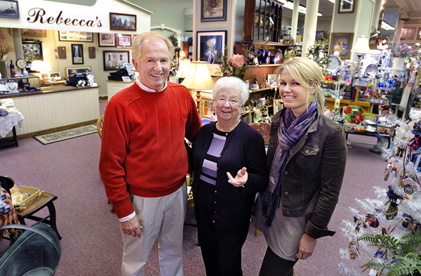 Owner Rick Vigue and employees Helene Rogan and Molly White, (L/R), celebrate 25 years in business in downtown Bangor.  Bangor Daily News/Michael C. York