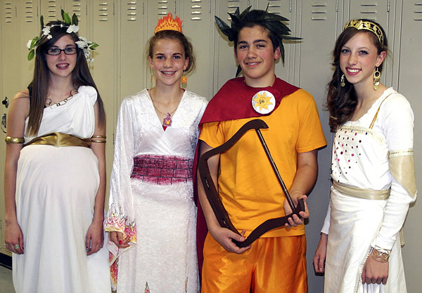 After reading ?The Lightning Thief? by Rick Riordan, which is based on mythology, in their freshmen English class, many of April Flagg?s students at Washburn District High School dressed up as their favorite mythological character. Among those participating were (from left) Taylor Blackstone-Thompson as Rhea, the mother of gods; Carmen Bragg as Hestia, goddess of the hearth; MacKenzie Hartford as Apollo, god of music, light and knowledge; and Carsyn Koch as Artemis, goddess of the hunt and the moon. PRESQUE ISLE STAR-HERALD PHOTO BY SCOTT MITCHELL JOHNSON