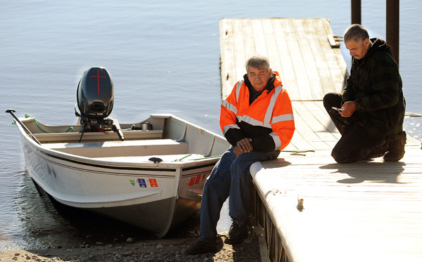 Searcher Allen Sockabasin, left, and George Bassett, father of William Hilderbrand, take a break from searching for Hilderbrand's body along the Penobscot River in Winterport on Friday. BANGOR DAILY NEWS PHOTO BY KEVIN BENNETT