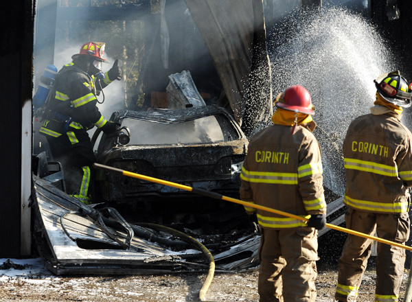Firefighters from Kenduskeag, Levant, Glenburn and Corinth battle an automotive garage fire on the Townhouse Road in Kenduskeag on Friday, November 12, 2010. A man working in the garage  was treated for smoke inhalation.  The building was a total loss. (Bangor Daily News/Kevin Bennett)