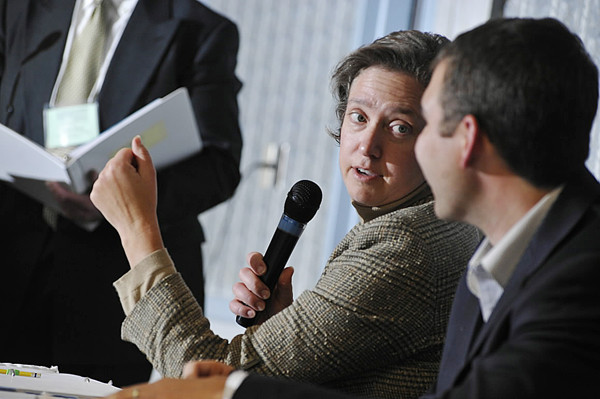 Betsy Bieman, president of Gardiner-based Maine Technology Institute, discusses a contestant's business pitch with fellow panelist and Eaton Peabody attorney Jeffrey Spaulding, right, during the five minute business pitch competition at Wednesday's Innovation to Venture conference in Orono. (Bangor Daily News/John Clarke Russ)