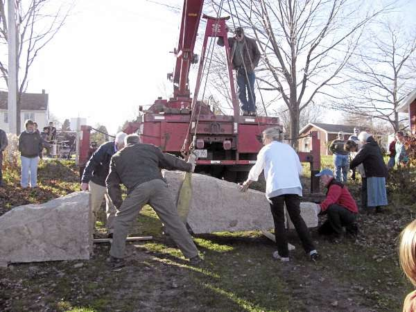 After artist Douglas Coffin split the 12,000 pound granite slab in two on Saturday afternoon, a crane separated the pieces, which will be used to mark the Allyn Street rangeway, or right-of-wa, in Belfast. (Abigail Curtis/BDN)