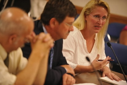 Sitting next to City Solicitor Norman Heitmann (from left) and her attorney Edmond Bearor, Bangor resident Angela Hoy addresses Bangor City Council subcommittee members Tuesday evening. With several convicted sex offenders living near their home in Bangor, Angela and Steve Hoy are concerned about the safety of neighborhood children, including their five children.  (BANGOR DAILY NEWS PHOTO BY JOHN CLARKE RUSS)  CAPTION  Sitting next to City Solicitor Norman Heitmann (far left) and her attorney Edmond. Bearor, Bangor resident Angela Hoy (far right) addresses a Bangor City Council  subcommittee members Tuesday evening, August 10, 2010. With several convicted sex offenders living near their home in Bangor,  Angela and Richard Hoy, are concerned about the safety of neighborhood children, including their five children. A Bangor City Council subcommittee voted Tuesday evening, August 10 to send to the full council an ordinance change that would put some restrictions on where sex offenders can live.  (Bangor Daily News/John Clarke Russ)