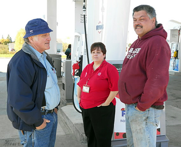 Standing at the Irving gas station on Route 1 in Harrington are Real Heroes Award winners, l. to r., Terry Grant, Raelea Merchant, and Mark Schoppee. (Photo courtesy of Pine Tree Chapter, American Red Cross)