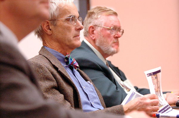 City Councilors Geoffrey Gratwick and Gerry Palmer Jr., right,  listen to consultants describe design proposals for the proposed Bangor Arena project during an informational workshop at City Hall Thursday evening. (Bangor Daily News/John Clarke Russ)