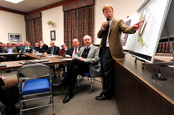 During Thursday evening's workshop in City Council chambers,  Don Detlefs, right, CEO of Colorado-based architectural firm Sink Combs Detlefs, describes different design scenarios for the proposed Bangor Arena project. (Bangor Daily News/John Clarke Russ)