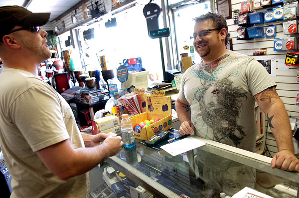 ALAN JACKSON TICKETS ON SALE   (Pete Nickerson of Bangor (left) buys two Alan Jackson concert tickets from Mark's Music store owner Mark Braveman in Brewer on Friday. Alan Jackson is scheduled to perform Sept. 10 as part of the Bangor Waterfront Concert Series that was announced earlier this week.  (BANGOR DAILY NEWS PHOTO BY BRIDGET BROWN)