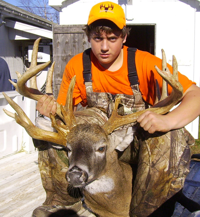 Lucas Clark, 15, of Northport poses with the 20-point deer he shot while hunting in Northport on Nov. 13. (Photo courtesy Lucas Clark) WITH HOLYOKE STORY SLUGGED: WEIRDRACK NOTE:  small file, no more than 2 1/2 cols.