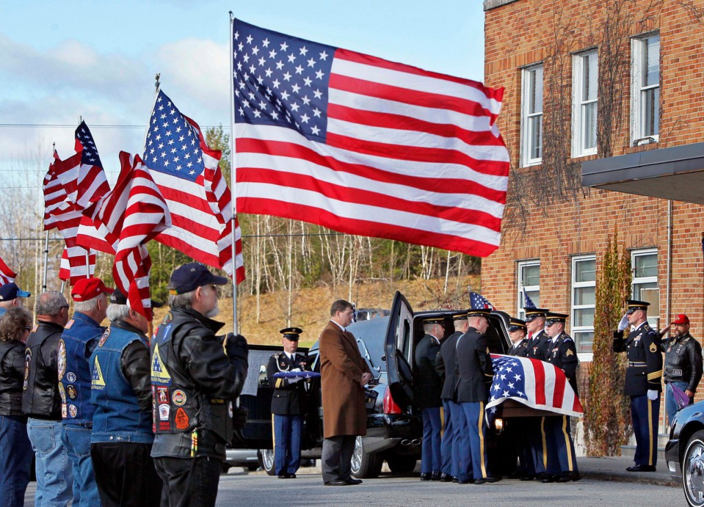 Pallbearers carry the casket of Army Cpl. Andrew L. Hutchins, of New Portland, Maine, Friday, Nov. 19, 2010, at his funeral service at the National Guard armory, in Augusta, Maine. Hutchins was killed in combat on Nov. 8, 2010, while serving in Khost province at a combat outpost in Sabari, Afghanistan. (AP Photo/Robert F. Bukaty)