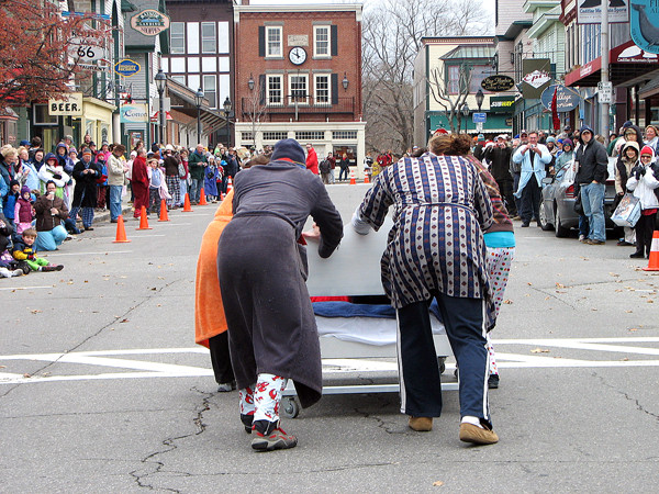 Members of Union Trust's &quotBed Heads&quot bed racing team line up at the starting line on Saturday, Nocvember 20, 2010  for Bar Harbor's Third Annual Bed Races, which are part of the Bar Harbor Chamber of Commerce's annual Pajama Sale. The team finished with the second fastest-time in the seven-team field, winning $200 to split among their five members and a trophy. (Bangor Daily News/Bill Trotter)