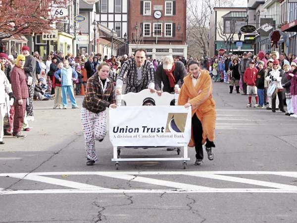 Members of Union Trust's &quotBed Heads&quot bed racing team cross the finish line on Saturday, November 20, 2010 during Bar Harbor's Third Annual Bed Races, which are part of the Bar Harbor Chamber of Commerce's annual Pajama Sale. The team finished with the second fastest-time in the seven-team field, winning $200 to split among their five members and a trophy. (Bangor Daily News/Bill Trotter)