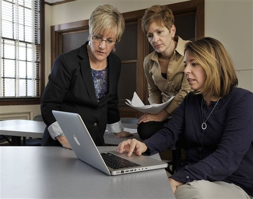 In this Nov. 19, 2010 photo, from left to right, professors Mary Madden, Elizabeth Allan and grad student Laurie Sidelko, are seen at the University of Maine in Orono, Maine. The trio are launching a &quotNational Agenda for Hazing Prevention in Education&quot based on their research. They found that 55 percent of college students involved in clubs, teams or other extracurricular organizations were hazed. (AP Photo/Michael C. York)