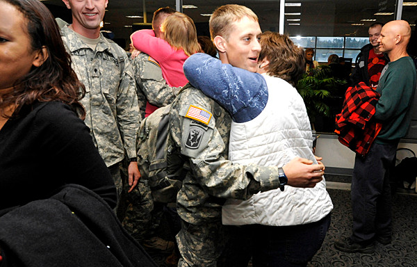 At Bangor International Airport Monday, Spc. Justin Harvey of Lincoln got a hug from his mother, Beth Harvey and other loved ones as he and 15 other soldiers with Bravo Company, 3rd Battalion-172nd Mountain Infantry unit returned from their year-long deployment in Afghanistan. (Bangor Daily News/John Clarke Russ)