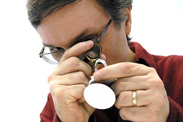 Barry Bolduc, a store manager at The Village Jeweler of Gardiner, checks a ring at The Lincoln Jeweler on Monday, Nov. 22, 2010. The Main Street store will open Friday. BANGOR DAILY NEWS PHOTO BY NICK SAMBIDES JR.