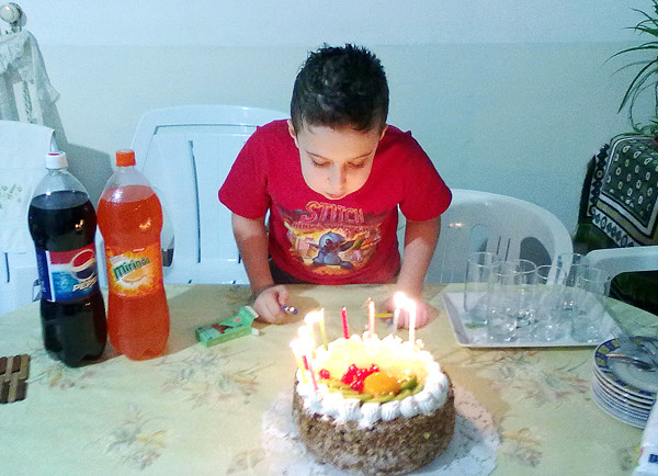 Ahmed Alsaleh at a party on his ninth birthday in Jordan in a photo sent to the boy's mother, Heidi Sides Alsaleh, by his father Mohammad Alsaleh.
