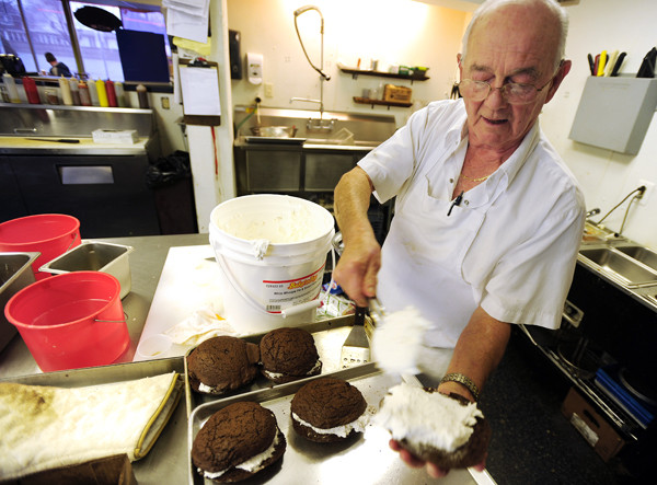 Jimmy Vardamis assembles whoopie pies in the kitchen at Jimmy V's Soups, Sandwiches and More on Hammond Street on Tuesday, November 23, 2010. (Bangor Daily News/Kevin Bennett)