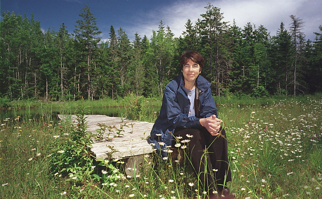 Naturalist Roxanne Quimby has a &quotseat fit for a queen,&quot surrounded by wildflowers near a small pond in Winter Harbor.  BANGOR DAILY NEWS PHOTO BY MICHAEL YORK