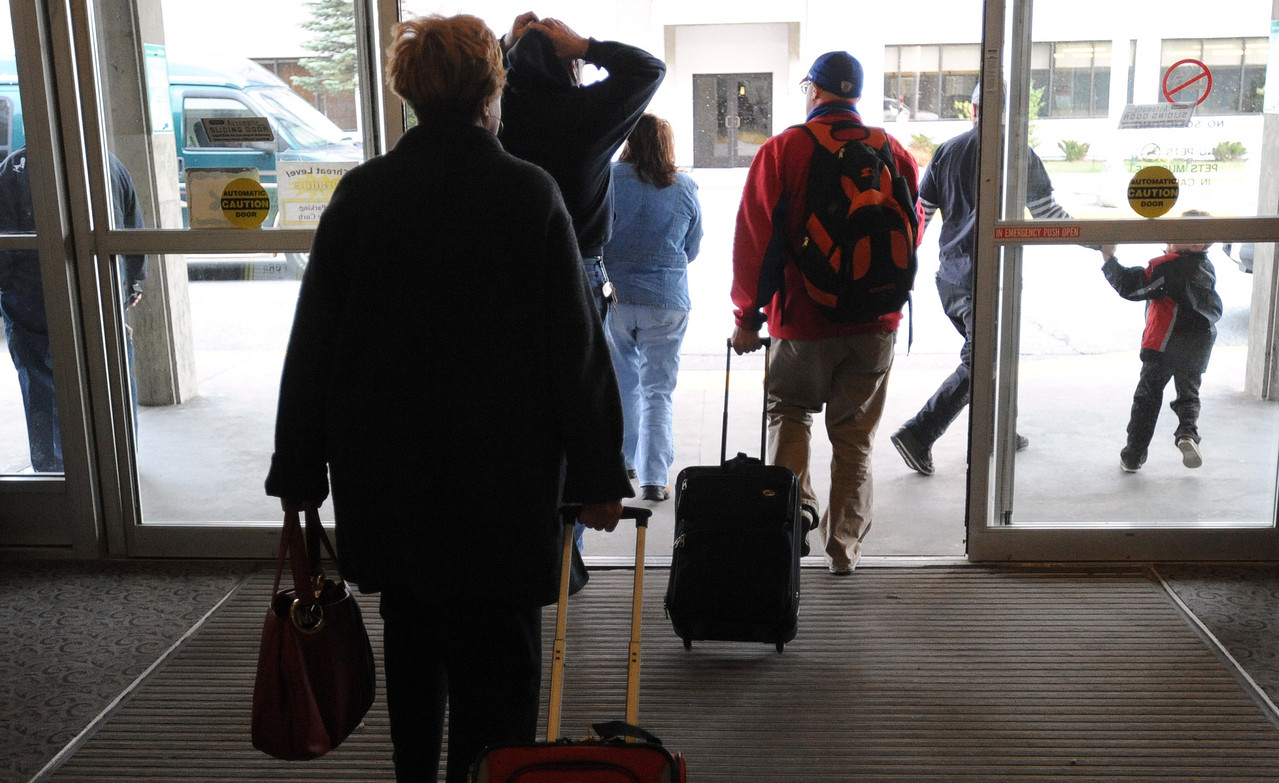 Travelers leave the Bangor International Airport Wednesday, Nov. 24, 2010.  Millions of people throughout the country travel to see family on the day before Thanksgiving, which is said to be one of the year's busiest travel days. (Bangor Daily News/Gabor Degre)