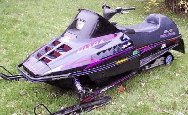 State Police are investigating the theft of a snowmobile in the town of Frankfort, which was stolen from the front yard of a residence on Tuesday afternoon .  Trooper Corey Smith said the 1996 Polaris Ultra was taken after it was loaded onto a utility trailer between 1 and 3 p.m.  The snowmobile was parked along the North Searsport Road with a for sale sign on it.   The trooper is asking motorists who traveled that road Tuesday afternoon who may have observed the theft to call.   Smith said the snowmobile is black with purple, pink and red accents and the front of the machine is marked with the the words &quot Indy SP&quot. Also the letter P is missing from the Polaris logo on the right side of the seat.   Anyone with information is asked to call State Police in Augusta at 624-7076.