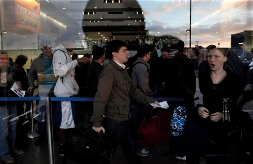 Travelers wait in line for security check at Los Angeles International Airport, Wednesday, Nov. 24, 2010. Holiday travelers dismayed by airport body scans planned protests at bustling airports Wednesday, while the head of the nation's transport security agency urged passengers to comply with searches to reduce the possibility of delays on one of the busiest travel days of the year. (AP Photo/Jae C. Hong)