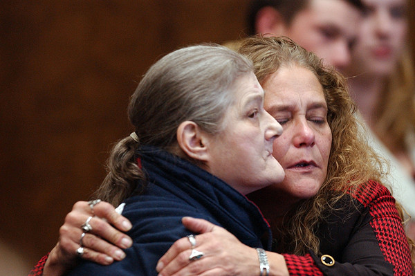 Trevon Cunningham's great-grandmother Lorraine Curtis (left) gets comforted by her daughter Debbie Cunningham at Jeffrey Coiokson's sentencing in Penobscot County Superior Court on Tuesday afternoon in Bangor. (BANGOR DAILY NEWS PHOTO BY KEVIN BENNETT)