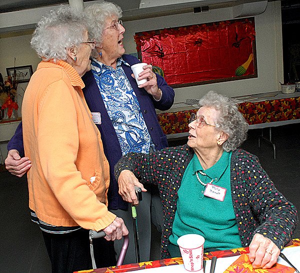 ORRINGTON, ME -- NOVEMBER 25, 2010 -- Sisters Louise Perkins, 87, (left),  Glenice Sawyer, 82, and Polly Bennett, 92,(sitting) sing &quotSide by Side&quot by Mitch Miller at the family Thanksgiving. They are daughters of Beulah and Vernon Smith who started the family Thanksgiving some 50 years ago. Four generations of the Smith family now get together at the First United Methodist Church in Orrington for the celebration.   LINDA COAN O'KRESIK