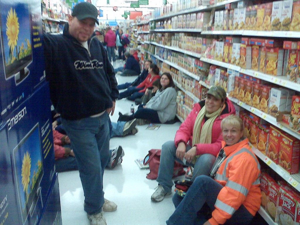 Robert Richards, left, of Saint John, New Brunswick, Canada and Hermon residents Margie Peterson and Kim Prouty are at the head of a line at the Brewer Wal-Mart Supercenter for a 32-inch television on sale during Black Friday. Richards arrived at the Wilson Street store at 6 p.m. and the Hermon women arrived at 7 p.m. for the midnight opening. After gaining entrance, the trio headed to another line in order to be one of 95 who would walk with the $198 TVs, which went on sale at 5 a.m. (Bangor Daily News/Nok-Noi Ricker)