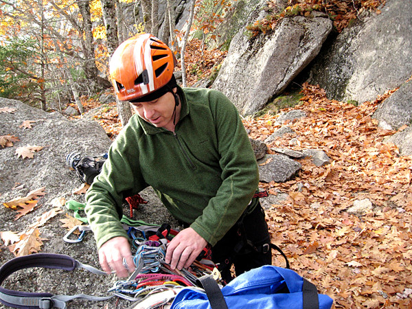 Tierney sorts out the pieces of protection he will use to safely ascend Parks Pond Bluff.