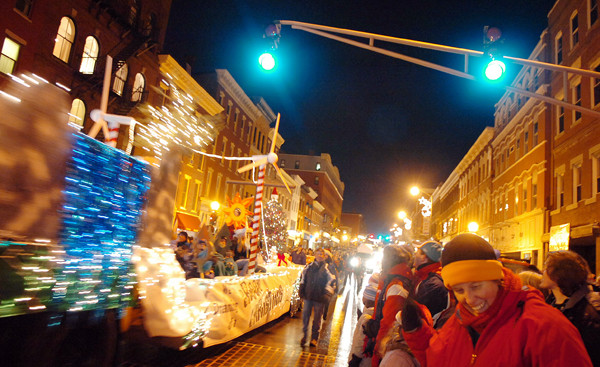 A FESTIVAL OF LIGHTS   Floats make their way down Main Stree during the parade. Forty-six units particpated in the parade with the theme &quotMaking Dreams Real.&quot