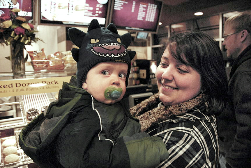 Reuben Langley awaits in line with his mother, Kristy Langley of Lincoln, at the new Tim Hortons in Lincoln on Wednesday, Nov. 24, 2010. (Bangor Daily News/ Nick Sambides Jr.)
